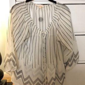 Off white and black printed shear top